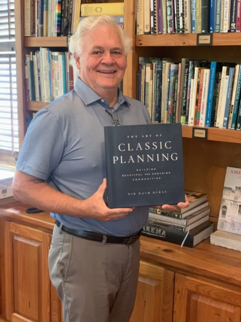 ICAA - LA Chapter President, Kevin Harris, holding his copy of Classic Planning by Dr. Nir Buras